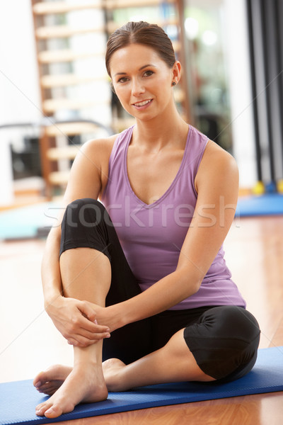 Woman Doing Stretching Exercises In Gym Stock photo © monkey_business