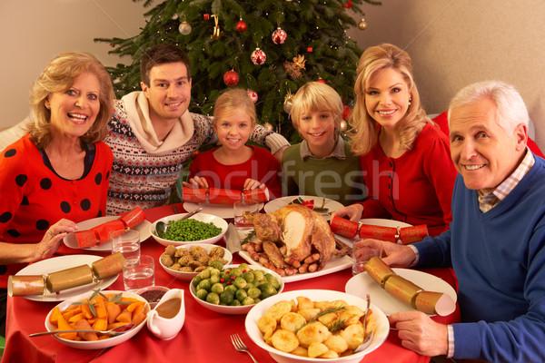 Three Generation Family Enjoying Christmas Meal At Home Stock photo © monkey_business