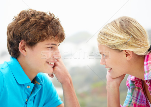 Teenage girl and boy head and shoulders in profile Stock photo © monkey_business