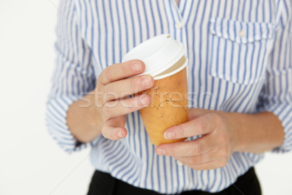 Businesswoman holding takeout coffee Stock photo © monkey_business