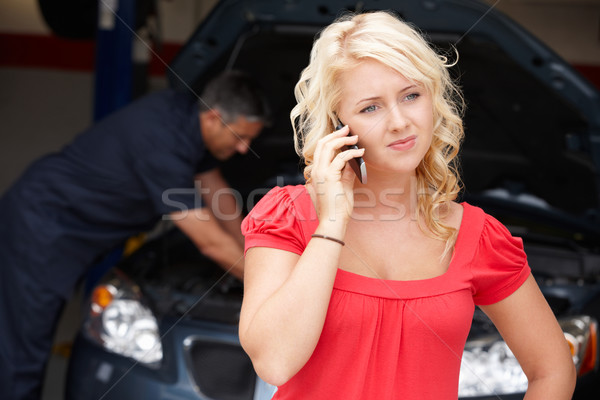 Young woman at auto repair shop Stock photo © monkey_business