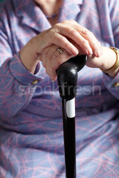 Close Up Of Senior Woman Holding Walking Stick Stock photo © monkey_business