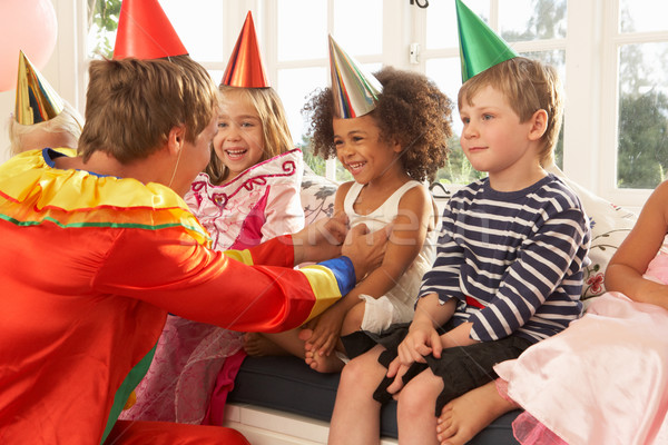 Stock photo: Clown entertaining children at party