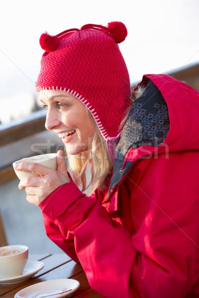Kadın sıcak içecek mutlu çift kar Stok fotoğraf © monkey_business