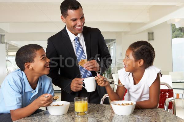 Pai café da manhã crianças trabalhar menina homem Foto stock © monkey_business