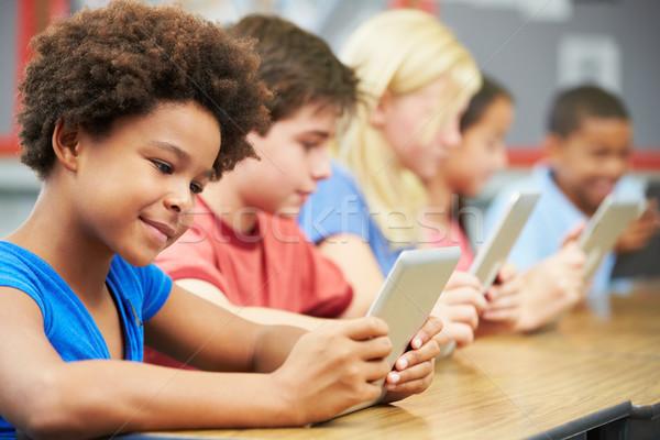 Foto stock: Alunos · classe · digital · comprimido · criança · educação