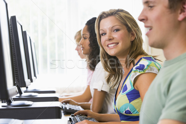 Stock photo: College students in a computer lab