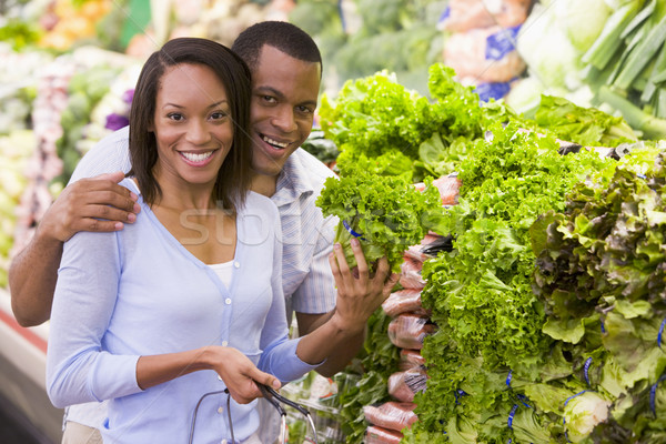 Couple achat supermarché femme alimentaire Photo stock © monkey_business
