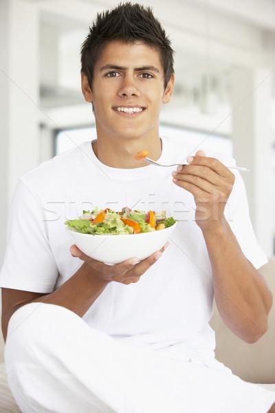 Moço alimentação salada comida homem feliz Foto stock © monkey_business