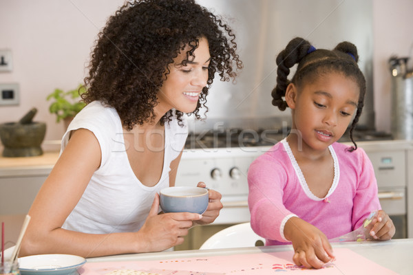 Woman and young girl in kitchen with art project smiling Stock photo © monkey_business