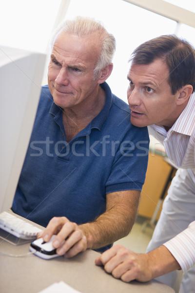 Mature male student learning computer skills Stock photo © monkey_business
