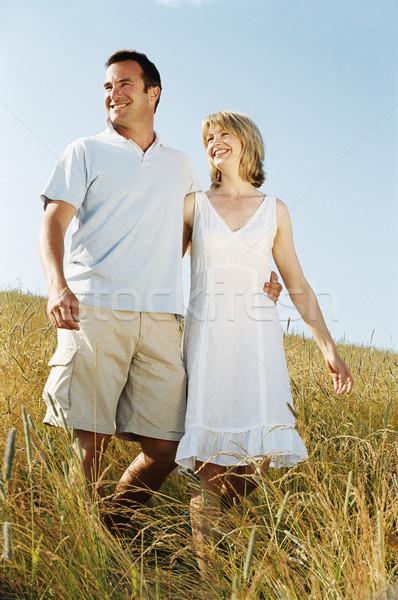 Casal caminhada ao ar livre sorridente mulher homem Foto stock © monkey_business
