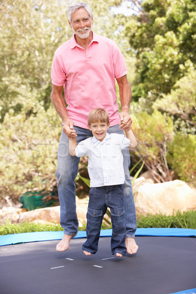 Avô neto saltando trampolim jardim retrato Foto stock © monkey_business