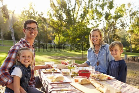 Family Painting Easter Eggs In Gardens Stock photo © monkey_business