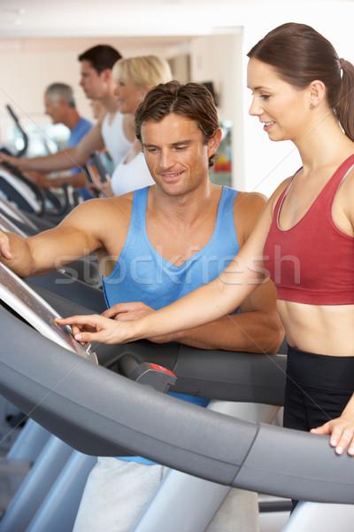 Kadın çalışma personal trainer çalışma makine spor salonu Stok fotoğraf © monkey_business