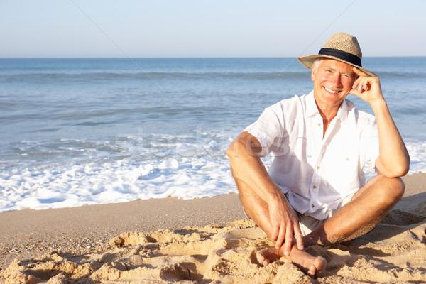Senior uomo seduta spiaggia rilassante Hat Foto d'archivio © monkey_business