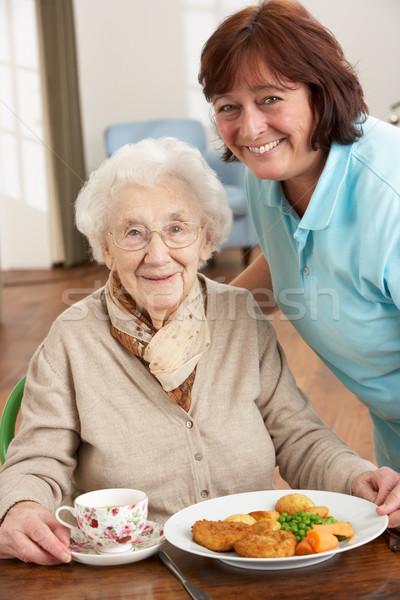 Idős nő felszolgált étel gondozó egészség Stock fotó © monkey_business
