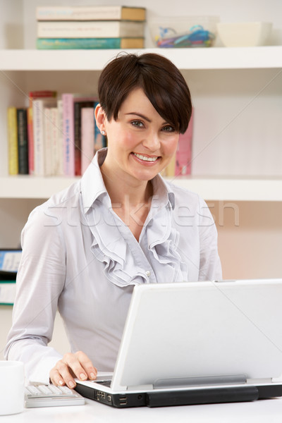 Woman Working From Home Using Laptop Stock photo © monkey_business