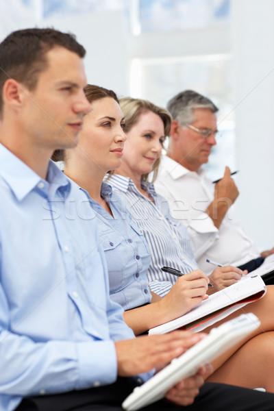 Group watching business presentation Stock photo © monkey_business