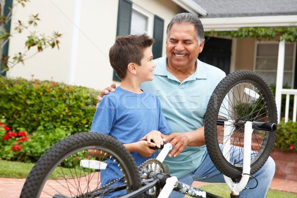 boy and grandfather fixing bike Stock photo © monkey_business