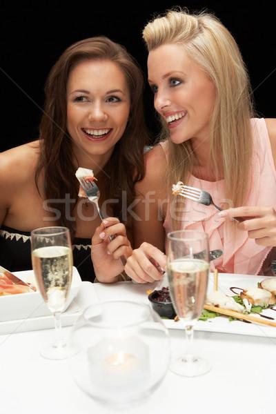 Fiatal nők étterem nő étel nők pár Stock fotó © monkey_business