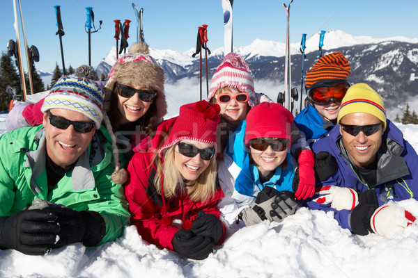 Two Family Having Fun On Ski Holiday In Mountains Stock photo © monkey_business