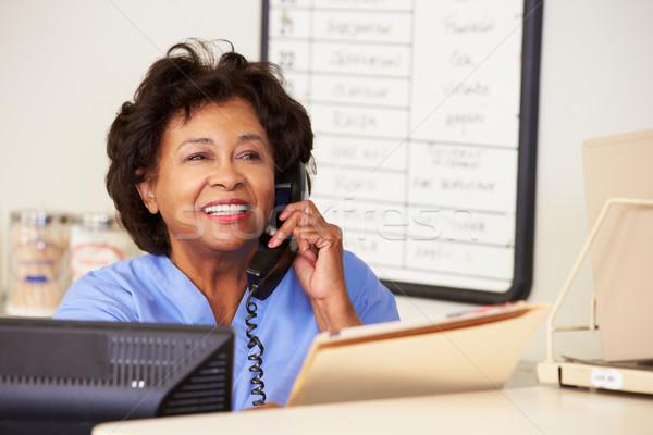 Nurse Making Phone Call At Nurses Station Stock photo © monkey_business
