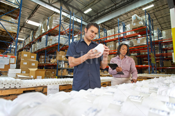 Factory Worker And Manager Checking Goods On Production Line Stock photo © monkey_business