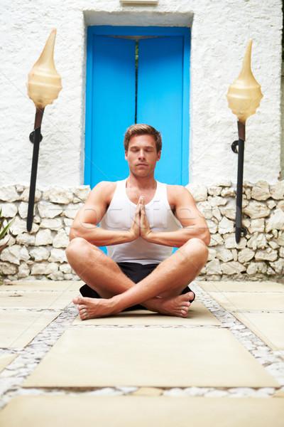 Man Meditating Outdoors At Health Spa Stock photo © monkey_business