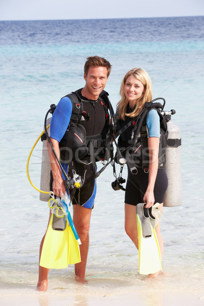 Couple With Scuba Diving Equipment Enjoying Beach Holiday Stock photo © monkey_business