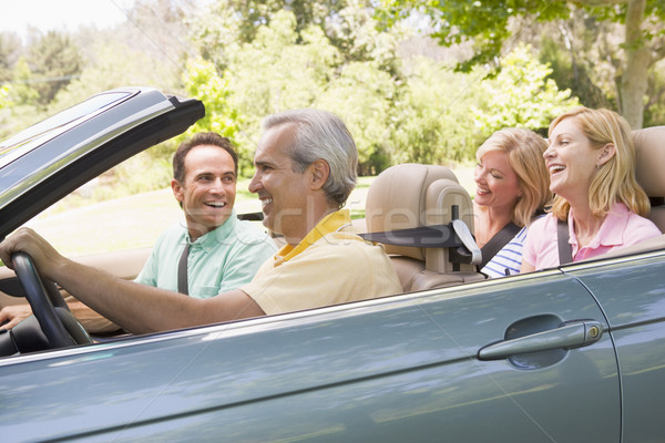 Stock photo: Two couples in convertible car smiling