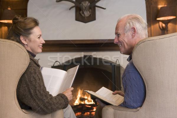 カップル 座って リビングルーム 暖炉 図書 笑みを浮かべて ストックフォト © monkey_business