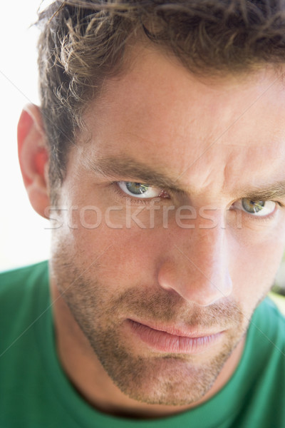 Head shot of man scowling Stock photo © monkey_business