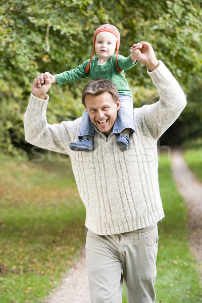 Father giving young son ride on shoulders Stock photo © monkey_business