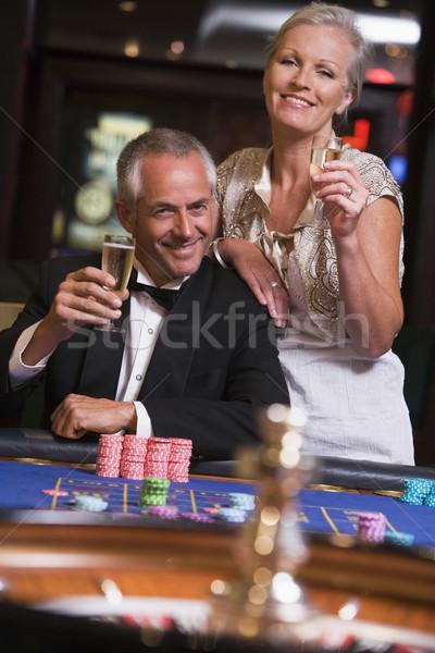 ストックフォト: カップル · ギャンブル · ルーレット · 表 · カジノ · 男