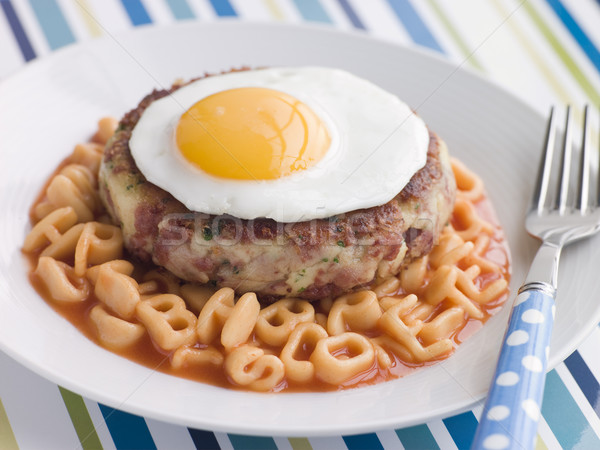 Corned Beef Hash Cake with Alphabet Pasta and a Fried Egg Stock photo © monkey_business