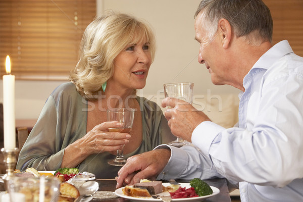Stock photo: Couple Enjoying A Meal At Home Together