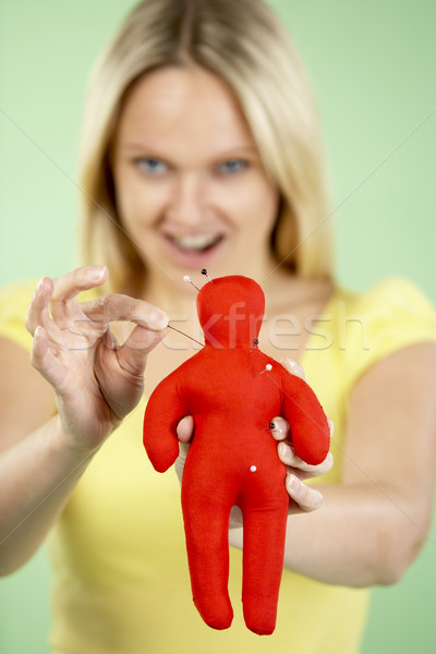 Woman Holding Voodoo Doll Stock photo © monkey_business