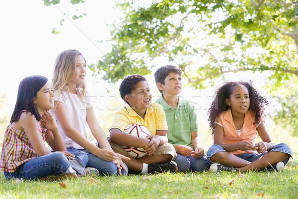 Cinque giovani amici seduta esterna soccer ball Foto d'archivio © monkey_business