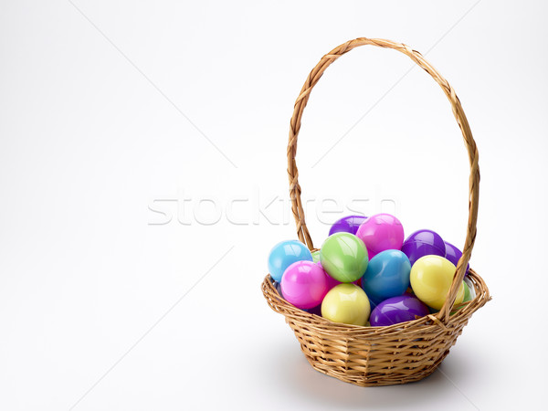 Stock photo: Basket Of Colorful Easter Eggs