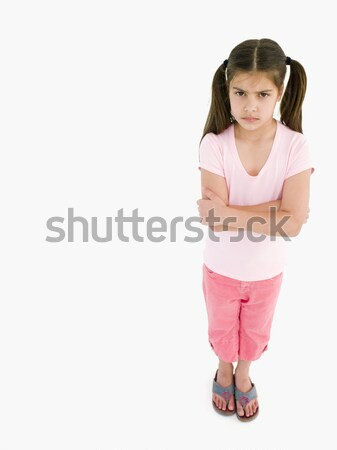 Stock photo: Young girl with arms crossed angry
