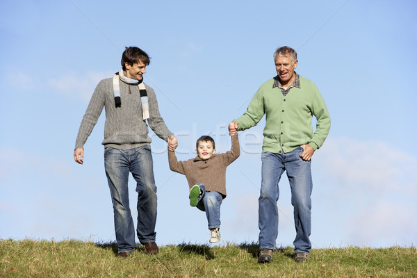 Father And Grandfather Swinging Young Boy Stock photo © monkey_business