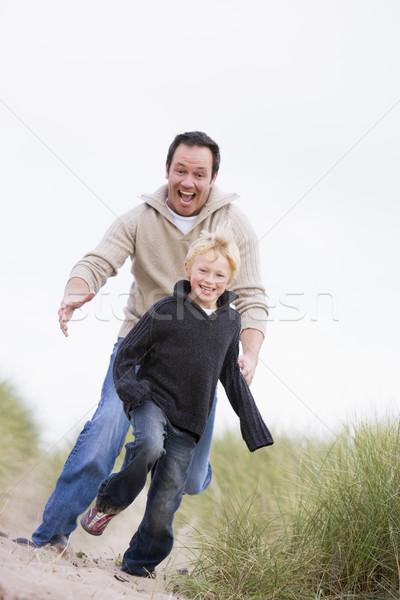 Сток-фото: отцом · сына · работает · пляж · улыбаясь · детей · ребенка