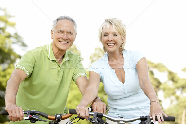 Mature couple riding bikes Stock photo © monkey_business