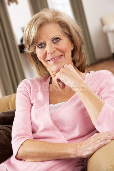 Senior Woman Relaxing In Chair At Home Stock photo © monkey_business