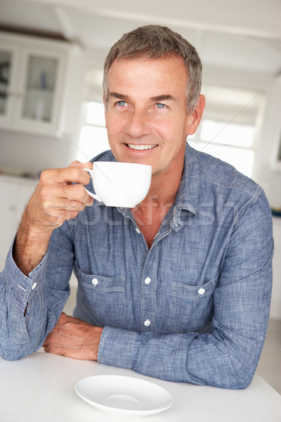 Stock photo: Mid age man with coffee at home
