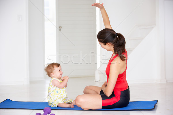 Mother and baby doing yoga Stock photo © monkey_business