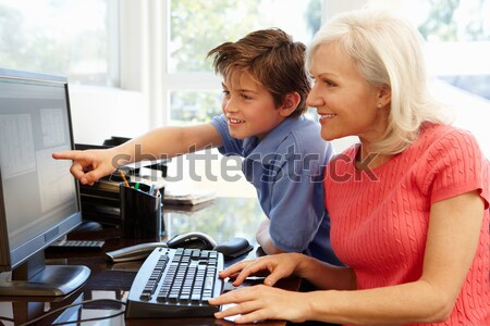 Teacher helping girl using computer in class Stock photo © monkey_business