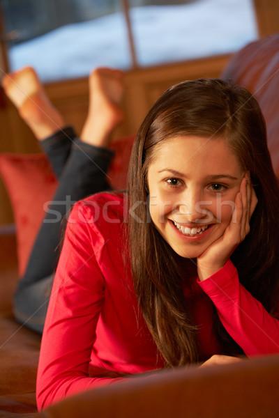 Teenage Girl Relaxing Lying On Sofa Stock photo © monkey_business