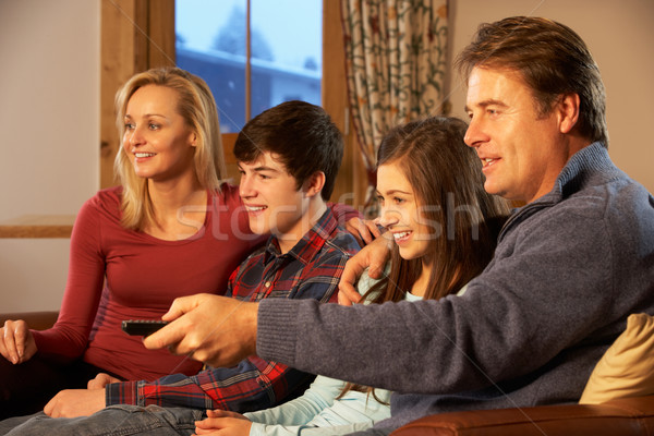 Portrait Of Family Relaxing On Sofa Together Watching TV Stock photo © monkey_business